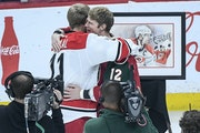 Minnesota Wild center Eric Staal (12) hugged his brother, Carolina Hurricanes center Jordan Staal (11), after a ceremony dedicated to Eric Staal in ho