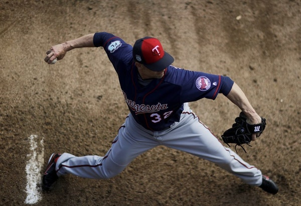 Minnesota Twins pitcher Ryan Vogelsong winds up to throw in the bullpen during a baseball spring training workout in Fort Myers, Fla., Thursday, Feb.