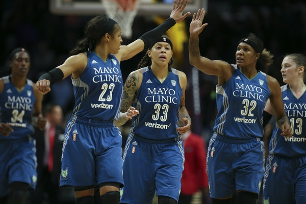 Maya Moore high-fived longtime teammate Rebekkah Brunson over Seimone Augustus with Lindsay Whalen at right. Sylvia Fowles, left, joined the Lynx last