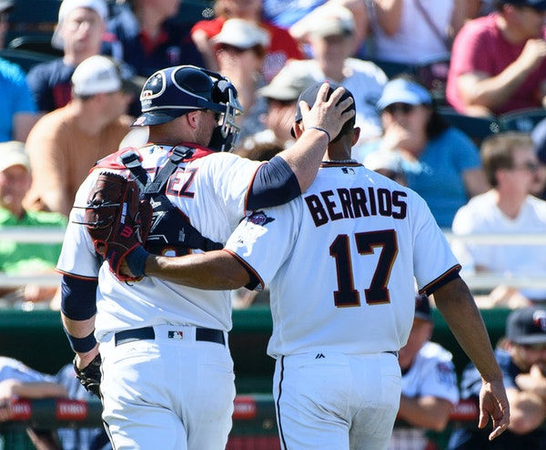 Twins catcher Chris Gimenez and pitcher Jose Berrios embraced after Berrios struck out Nationals right fielder Brian Goodwin to end the top of the fou