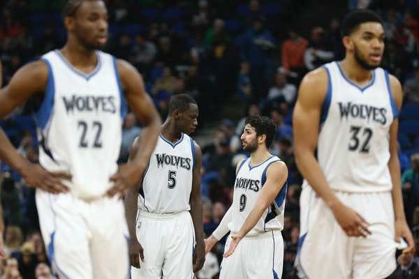 Minnesota Timberwolves teammates center Gorgui Dieng (5) and guard Ricky Rubio (9) talk after a foul was called in Monday's game vs. Portland.