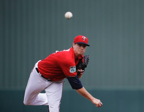Minnesota Twins starting pitcher Kyle Gibson throws in the first inning of an exhibition spring training baseball game against the Pittsburgh Pirates