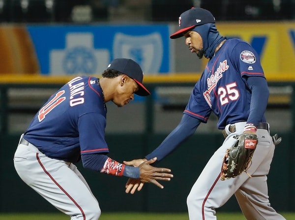 Minnesota Twins shortstop Jorge Polanco (11) celebrates with center fielder Byron Buxton (25) after their win over the Chicago White Sox, Friday, Apri
