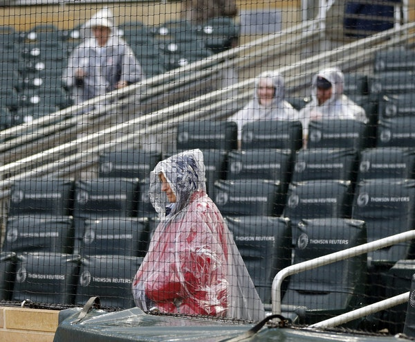 An usher wasn't afraid of the elements during a rain delay last Friday, with the help of his rain poncho. Wednesday's postponement because of rain