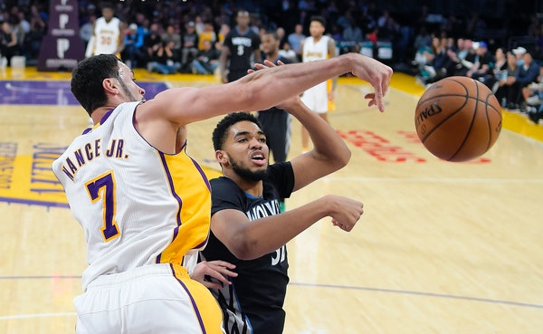 Lakers forward Larry Nance Jr., left, and Timberwolves center Karl-Anthony Towns went after a rebound during the first half Sunday.