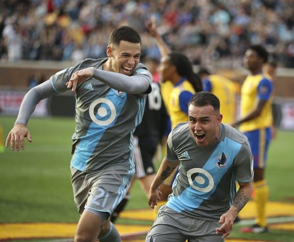 Minnesota United forward Christian Ramirez (21) helped Minnesota United midfielder Miguel Ibarra (10) celebrate a goal