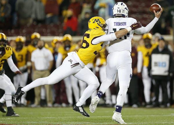Gophers linebacker Blake Cashman put the pressure on Northwestern quarterback Clayton Thorson in the fourth quarter Saturday.