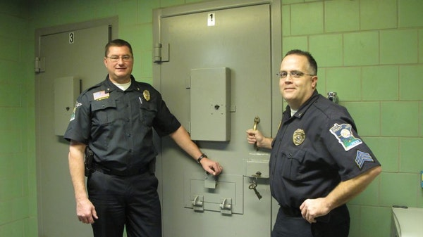 Forest Lake Police Chief Rick Peterson, left, and Capt. Greg Weiss (then a sergeant) in 2011
