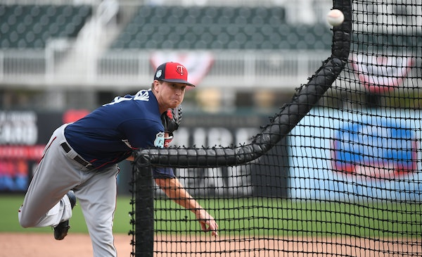 Twins pitcher Kyle Gibson threw the ball over protective netting while pitching during live batting practice