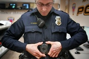 More police departments are using body cameras, including Maplewood, where officer Parker Olding attached his to a magnetic plate inside his uniform.