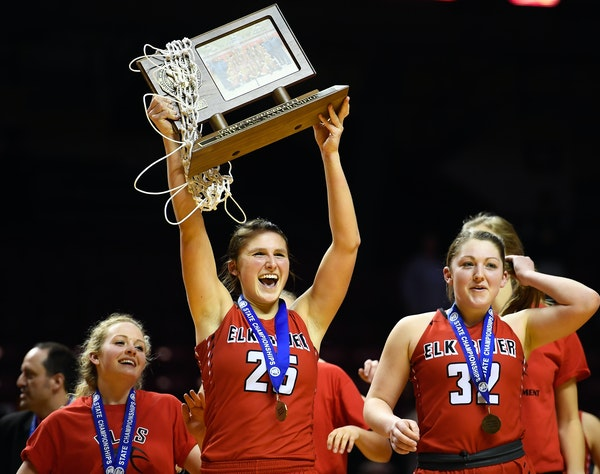 Elk River forward Sidney Wentland hoisted the Class 4A championship trophy as she marched toward the student section with teammates, including guard a