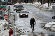 In 2014, bicyclists rode along 28th Street where it intersects with the Midtown Greenway in Minneapolis. The role of 28th and the Greenway is being ho