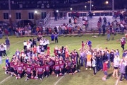 Moments after the Staples-Motley Cardinals broke a 39-game losing streak in 2015 with a 24-14 victory, fans stormed the football field to celebrate.