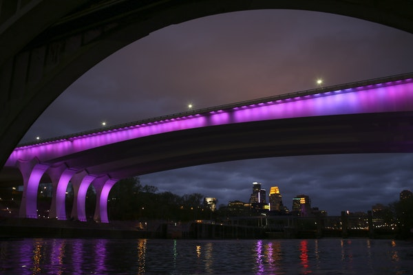Jeff Wheeler/Star Tribune Landmarks around the Twin Cities, such as the I-35W bridge, will be bathed in purple Thursday to mark the anniversary of Pri