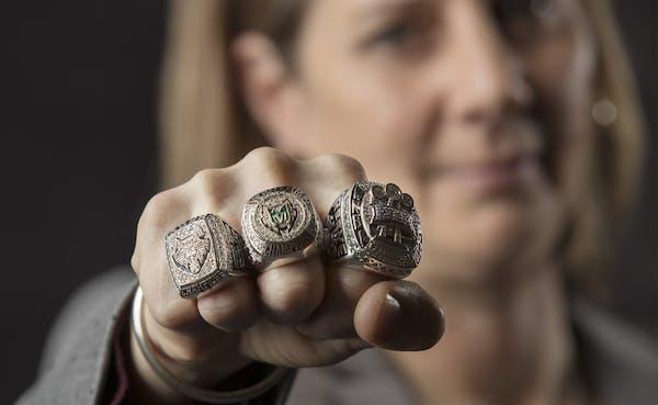Lynx head coach Cheryl Reeve showed the three championship rings that her team has won.