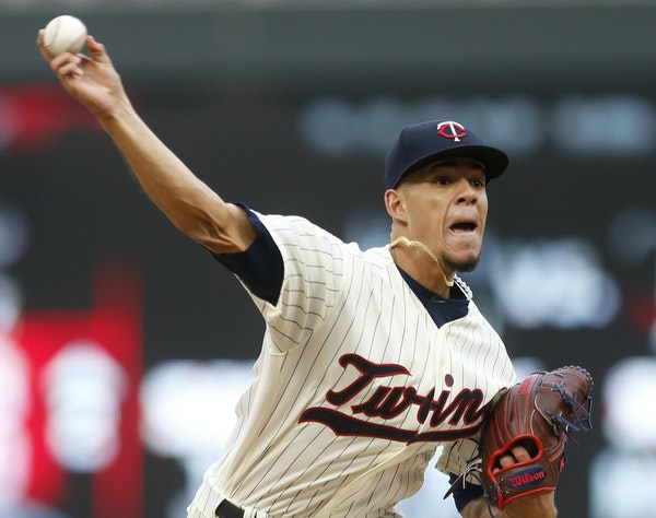 Minnesota Twins pitcher Jose Berrios throws against the Colorado Rockies during the third inning of the second game of a baseball doubleheader Thursda
