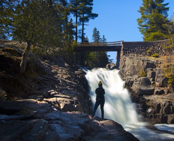 You don't have to travel far up the shore to find great waterfalls. Charlotte Nash takes a photo of Amity Creek Falls along Seven Bridges Road in Dulu