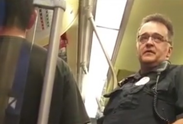 In this photo taken from video, a Metro Transit police officer asked a Blue Line light-rail passenger for his immigration status, leading another pass