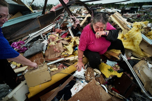 """Cindy Rutledge, was crying out, """"Colby, Colby"""" as she looked for her dachshund in the wreckage of her trailer home.On the left is daughter Deeann."""