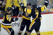 The Penguins' Jake Guentzel, center, celebrated his goal against the Nashville Predators with Ian Cole, left, and Matt Cullen during the third period