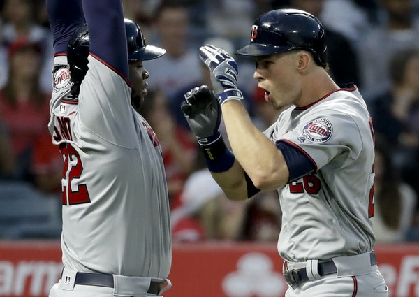 Max Kepler celebrated with Miguel Sano after both scored on Kepler's homer, the Twins' third two-run homer of Friday's game.