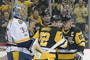 The Penguins' Patric Hornqvist (72) and Sidney Crosby (87) will have a challenge solving goalie Pekka Rinne, left, and the Predators' brilliant corps