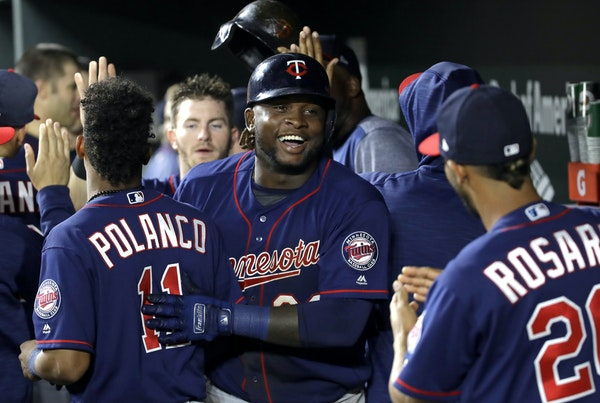 Miguel Sano flashed a big smile while celebrating his two-run homer with teammates in the ninth inning.