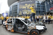 Nashville Predators fan Nick Olp swings a sledge hammer as he takes a turn beating up a car painted with Anaheim Ducks logos before Game 6 of the West