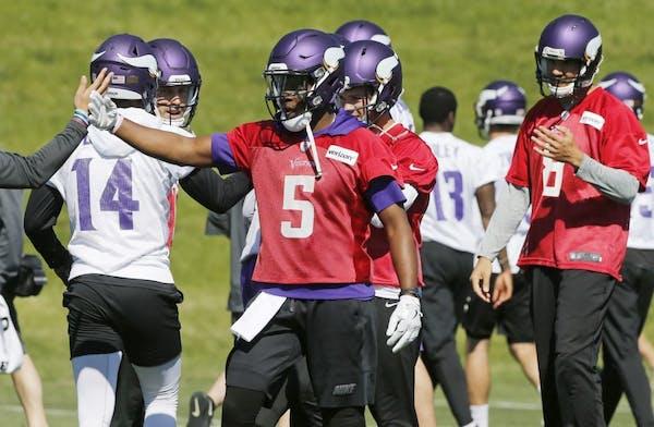 Minnesota Vikings quarterback Teddy Bridgewater (5) joins other quarterbacks including Sam Bradford, right, during the NFL football teams practice Tue