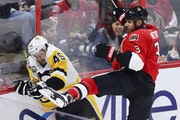 Pittsburgh Penguins right wing Josh Archibald (45) is checked by Ottawa Senators defenseman Marc Methot (3) during the first period of Game 4 of the N