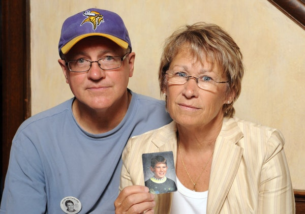 Patty and Jerry Wetterling hold a photo of their son Jacob, who was abducted in October of 1989 in St. Joseph, Minn.