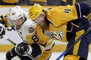 Penguins captain Sidney Crosby, left, battled Nashville defenseman Ryan Ellis for position during Game 3 on Saturday night.
