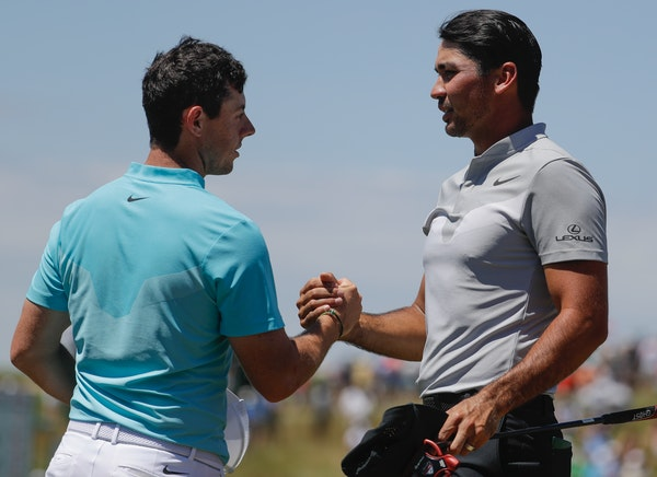 Rory McIlroy, left, and Jason Day shook hands after they completed their second round at Erin Hills. Neither will be around for the third round.