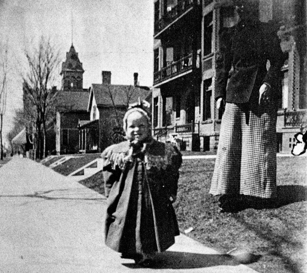F. Scott Fitzgerald, age 1, in 1897, in front of his parents' apartment at 481 Laurel Av., St. Paul.