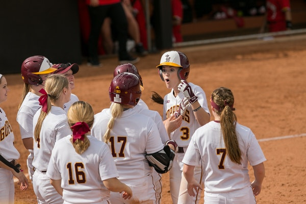 MaKenna Partain celebrated with other members of the Gophers softball team earlier this season.