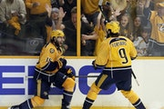 Nashville Predators right wing Craig Smith (15) celebrates his goal against the Pittsburgh Penguins with Filip Forsberg (9), of Sweden, during the thi
