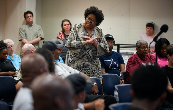 Coming together: A woman at the Hallie Q. Brown Community Center urged community members to push for change.