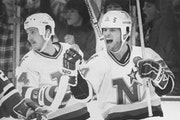Dino Ciccarelli, right, celebrated a goal with North Stars teammate Steve Payne in 1985. Four years earlier, Ciccarelli set the NHL rookie record for