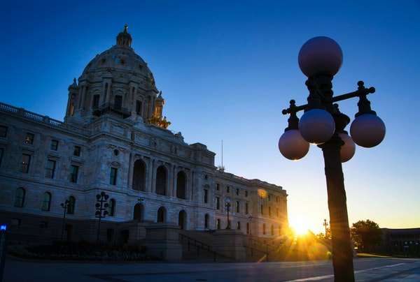 The sun rised behind the Capitol on Wednesday, as lawmakers continued their work inside.