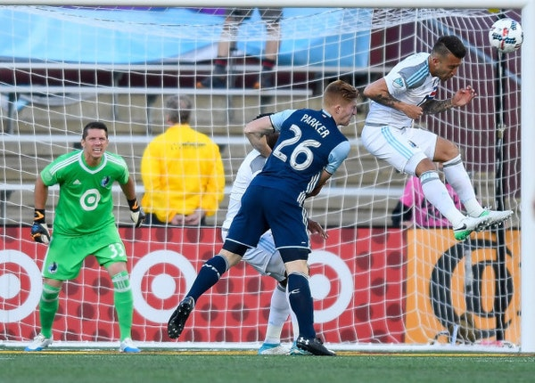Minnesota United defender Francisco Calvo (5) headed away the ball while guarding Vancouver Whitecaps defender Tim Parker (26) in the second half Satu