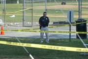 A police officer stood watch near strewn baseballs after Wednesday's shooting in Alexandria, Va., that injured House Majority Whip Steve Scalise of