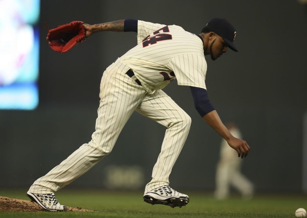 Minnesota Twins starting pitcher Ervin Santana reached for the ball after knocking down a line drive by Los Angeles Angels first baseman Luis Valbuena