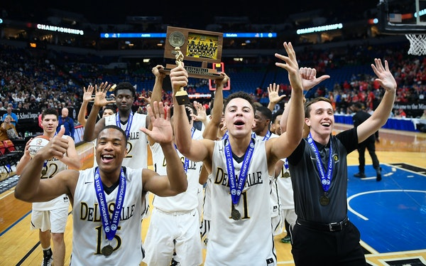 DeLaSalle players, including guards J.T. Baker (15) and Gabe Kalscheur (11), celebrated their sixth consecutive Class 3A boys' basketball championship