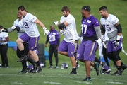 Riley Reiff, center, took to the field for practice at Winter Park, Wednesday, June 14, 2017 in Eden Prairie, MN.