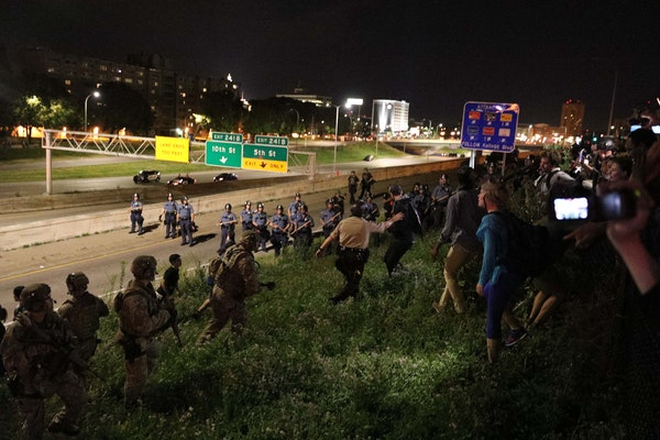 Police round up demonstrators at I94 and Dale St. early Saturday morning, making several arrests. Earlier, supporters of Philando Castile held signs a