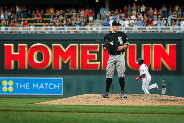 Chicago White Sox starting pitcher Derek Holland stands on the mound as Minnesota Twins' Kennys Vargas runs the bases on a three-run home run during t