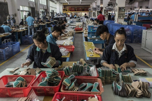 Workers on an assembly line at a Huajian International shoe factory, which makes shoes for Ivanka Trump and other designers, in Dongguan, China, Dec.