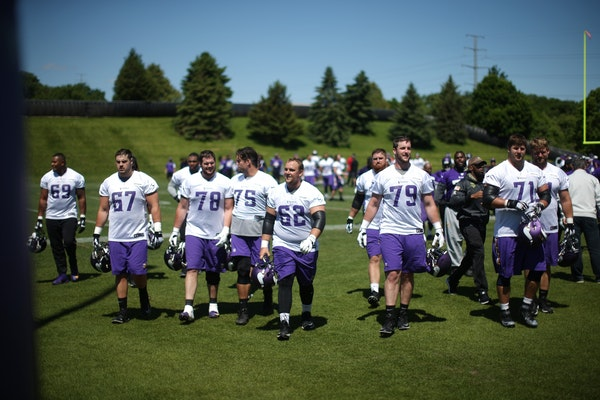 Members of the Vikings offensive line walked of the field after practice Wednesday May 31,2017 in Eden Prairie, MN.