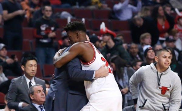 Chicago Bulls' Jimmy Butler, center, hugs Minnesota Timberwolves' head coach Tom Thibodeau, left, hugged before their game last December in Chicago.