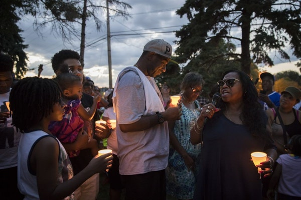 At right, Valerie Castile, the mother of Philando Castile, spoke during a candlelight vigil Thursday held in Falcon Heights where Philando was shot on
